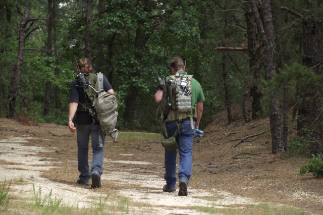 "Engineers representing squad members head into the woods during a 36 node SRW assessment. When squads spread out, they can potentially loose communications due to obstructions in the terrain. SRW is ""exciting"" because the network ""self heals"" its fragmented connectivity by leveraging other squad radios using the waveform."