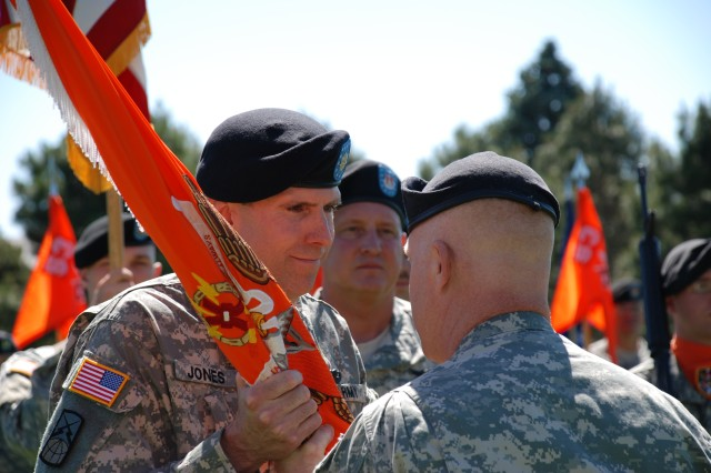Lt. Col. Benjamin Jones receives the battalion colors and command responsibility for the 53rd Signal Battalion from Col. Jeffrey Farnsworth, commander of the 1st Space Brigade.