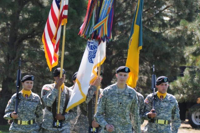 Lt. Col. Timothy Cassibry, commander of troops for the change of command ceremony, leads the color guard forward.