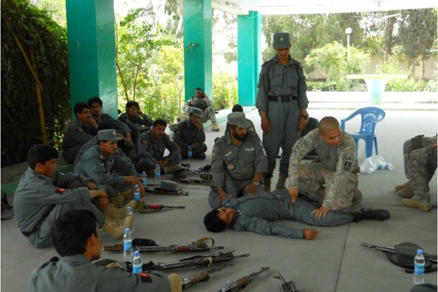 KHOST PROVINCE, Afghanistan - U.S. Army Spc. Paolo Flores, from San Diego, Khost Provincial Headquarters squad medic, 330th Military Police Company, conducts combat casualty care and first aid training with Afghan Uniformed Policemen at the Khost Provincial Headquarters June 27. Soldiers from 330th Military Police Company, 95th MP Battalion, Task Force Sheriff, lead the two-day course, which taught law enforcement skills including basic weapons handling, safety, combat casualty care and first aid.