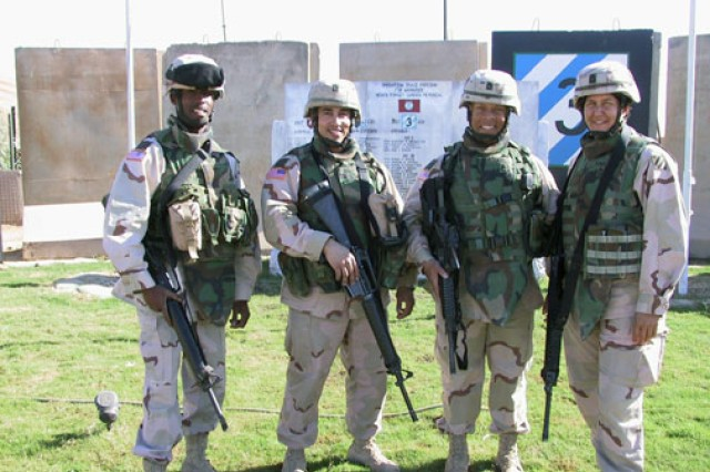 Master Sgt. Barbara Rubio (far right) poses with battle buddies during her deployment to Iraq. Rubio completed the Army Congressional Fellowship Program, and is now the legislative assistant to the sergeant major of the Army.