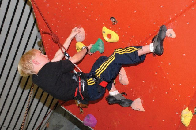 CYS Services Gym Ratz participant Caleb Elliott, 9, expertly negotiates the climbing wall in the Panzer Fitness Center June 25.