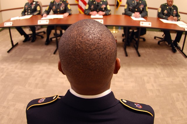 Army Staff Sgt. Elite E. Pierre, with the Fort Dix Noncommissioned Officer Academy, sits in front of the Soldier Appearance Board during the 2010 Divisional Best Warrior Competition held at Fort McCoy on 7 June 2010. Photo by Sgt 1st Class Chris Farley, 88th Regional Support Command Public Affairs Office