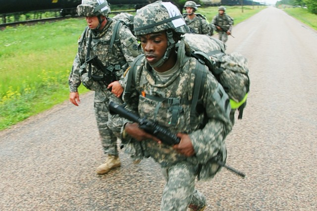 Army Staff Sergeant Earl J. Morgan, with the 784th Transportation Brigade, marches in front with Army Staff Sergeant Jason R. Fiedler on left, with the 310 Expeditionary Sustainment Command, in the course of an approximately 10 kilometer road march event during the 2010 Regional Best Warrior Competition held at Fort McCoy on 08 June 2010. Photo by Sgt 1st Class Farley, 88th Regional Support Command Public Affairs Officer.
