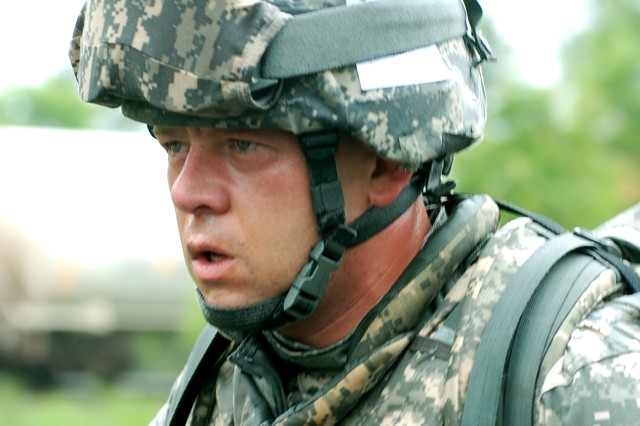 Army Staff Sergeant Jason R. Fiedler, with the 310 Expeditionary Sustainment Command, shows signs of exhaustion in the course of an approximately 10 kilometer road march event during the 2010 Regional Best Warrior Competition held at Fort McCoy on 08 June 2010. Photo by Sgt 1st Class Farley, 88th Regional Support Command Public Affairs Officer.