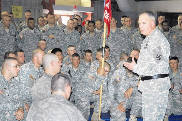 Brig. Gen. David Weeks addresses members of the 299th Engineer Company during Sunday's mobilization ceremony at Wells Field House. More than 180 Soldiers will be deploying to Iraq in support of bridge operations throughout the country.