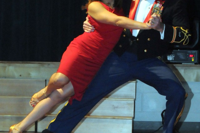 """Col. Anthony Krogh, director of simulation here, and his dance partner, Marta Trevathan, dance a rumba during the inaugural """"Dancing with the Stars, Dothan Style,"""" at Covenant United Methodist Church in Dothan June 26. The charity event raised $13,000 for the Dothan-Houston County Substance Abuse Partnership."""