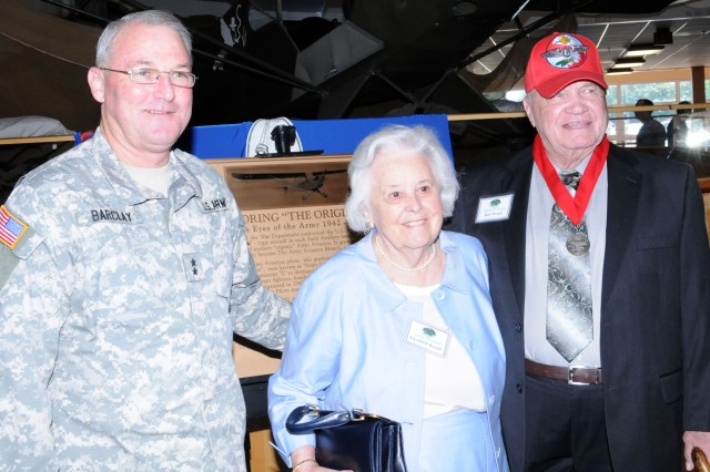 "Maj. Gen. James O. Barclay III, USAACE and Fort Rucker commanding general, greets Elisabeth and Russ Baugh June 25 at the U.S. Army Aviation Museum in front of a plaque dedicated to the Piper Cub Club ""Originals."" Club members were honored for their contributions to Army Aviation."