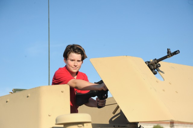 Afton LaMere from Alexandria, VA, explores a static display at the June 30, 2010 Twilight Tattoo.