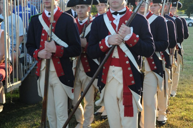Members of Alpha Company wait for the cue for the finale of the last Twilight Tattoo of the season on June 30, 2010.