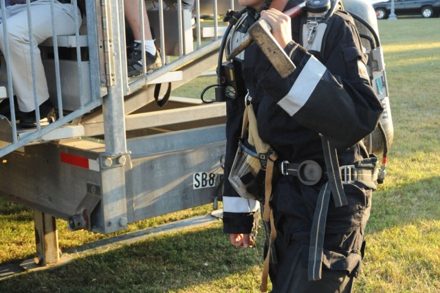 A member of the 911th Engineer Company prepares to walk onto the field as the announcer talks about important role of the unit in the Nation's Capital and during 911 at the June 30, 2010, Twilight Tattoo.