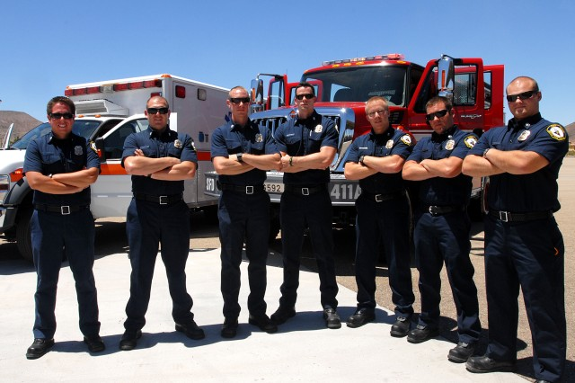 (Left to right) Seven of the nine, new firefighter paramedics on Fort Irwin and the National Training Center: Joshua Mendoza, Vincent Myers, Nicholas Pope, Chris Holloway, Garrett Robillard, Brad Micallef, and Matthew Perkins.