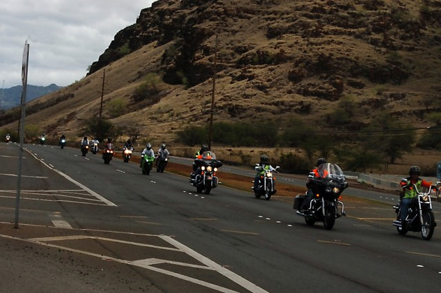 """Soldiers and officers of the 25th Infantry Division ride back to Schofield Barracks during the """"Freedom Ride"""" June 30, after donating non-perishable foods to Kahikolu 'Ohana Hale 'O Wai'anae homeless shelter, Waianae, Hawaii. """"The main purpose of today's ride was to get as many riders as we could throughout the military community and the civilians that would like to participate, and to bring canned goods that we can donate to the homeless shelter,"""" said 1st Sgt. Steven Sonnen, 25th Inf. Div. Band."""