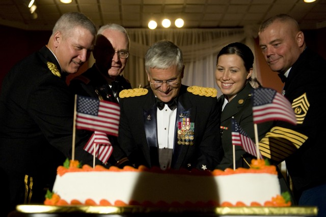 """Army Chief of Staff George W. Casey Jr. participates in cutting the cake as part of the U.S. Army Signal Corps' 150th Birthday Celebration on Fort Gordon, Ga., June 25, 2010. """"The Signal Corps will be an essential element of the force for a long time,"""" said Casey. The United States Army Signal Corps develops, tests, provides, and manages communications and information systems support for the command and control of combined arms forces."""