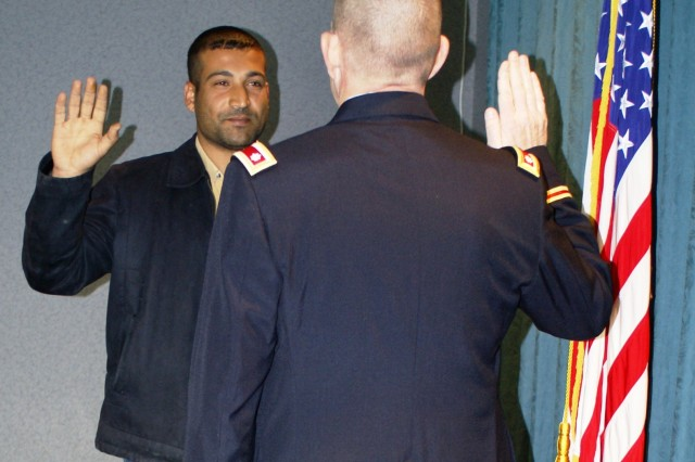 Lt. Col. Gene Snyman, deputy commander of the U.S. Army Corps of Engineers Tulsa District, administers the U.S. Army oath of enlistment to Ahmed Al Jibori March 26 at the district headquarters in Tulsa, Okla.