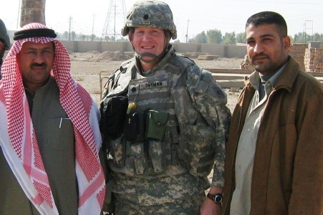 Lt. Col Gene Snyman poses with Ahmed Al Jibori, right, and Mr. Quatan, provincial engineer for Salah Ah Din, in Iraq.