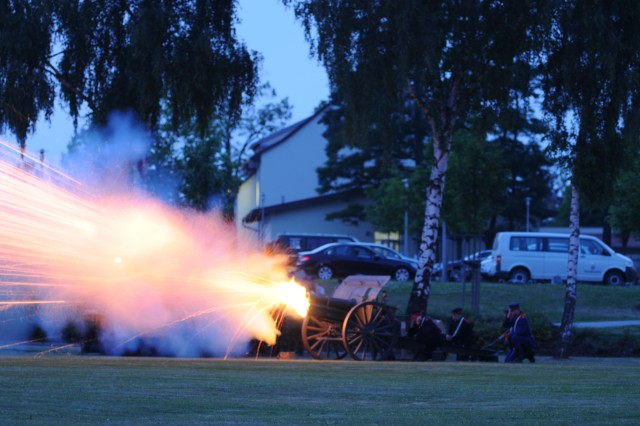 Bundeswehr soldiers fire an early 20th-century howitzer during a ceremonial reenactment of the first training shot fired at the Grafenwoehr Training Area 100 years ago.  The reenactment was part of the celebration of the Grafenwoehr Training Area's centennial June 30, 2010.