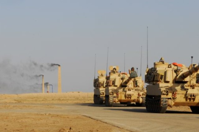 Paladin howitzers from the 1st Battalion, 10th Field Artillery Regiment, 3rd Heavy Brigade Combat Team, 3rd Infantry Division, prepare to move the firing line at the Bani Rabia range, near al-Kut, Iraq, June 19, 2010. The live fire exercise was the culmination of a training event spanning back to mid-May, where sections trained on individual drills and moved on to integrated training. (U.S. Army photo by Spc. Samuel Soza)