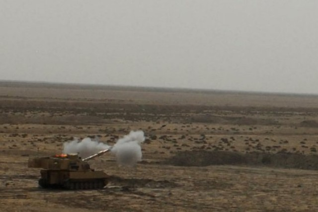 A Paladin howitzer from Battery B, 1st Battalion, 10th Field Artillery Regiment, 3rd Heavy Brigade Combat Team, 3rd Infantry Division, fires at a target 5,600 meters away at the Bani Rabia range, near al-Kut, Iraq, June 19, 2010. During the live fire exercise, 104 rounds were fired by 16 howitzers crews. (U.S. Army photo by Spc. Samuel Soza)