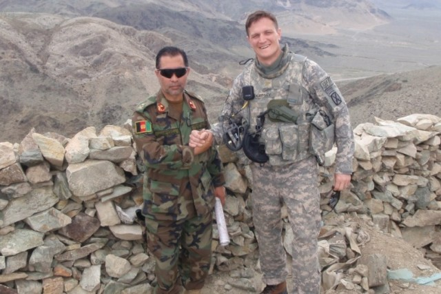 Lt. Col. Jason Dempsey, right, with his Afghan counterpart scouting an observation post near the Pakistani border in Afghanistan in 2009. Dempsey was selected as one of 13 out of more than 700 candidates for the 2010-2011 White House Fellows program.