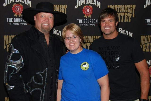 Spc. Jessica Printy with Montgomery Gentry at their country concert since her cancer diagnosis in 2008 of Hodgkin's Lymphoma. She is starting a cancer survivor's group to discuss conditions and give support at Fort Belvoir, Va.