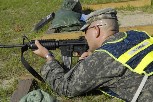 SSG Michael Cramer takes aim with an M4 rifle during the target shoot.