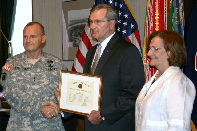 Lee Thompson, executive director of the Logistics Civil Augmentation Program, receives a Department of the Army Certificate of Appreciation, among other decorations, at the June 29th retirement ceremony held at the Rock Island Arsenal's Heritage Hall. The ceremony was hosted by Maj. Gen. Yves J. Fontaine, commanding general of the Army Sustainment Command.