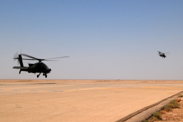 Two U.S. AH-64 Apaches from Company C, 1st Attack Reconnaissance Battalion, 1st Aviation Regiment, depart Contingency Operating Base Basra, Iraq, June 27, 2010, after a joint reconnaissance mission along the Iranian border with the Iraqi Air Force's 70th Squadron. The mission was the first such joint patrol of the Iranian border for U.S. and Iraqi forces.