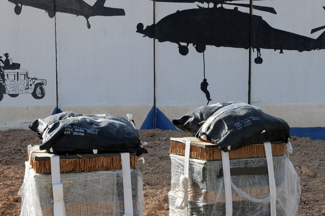 BAGHDAD - Two Low Cost, Low Altitude Aerial Resupply System bundles, delivered June 20 by Soldiers assigned to 307th Brigade Support Battalion, 1st Advise and Assist Brigade, 82nd Airborne Division, United States Division - Center, now belong to Iraqi Special Operations Forces at Al Asad Air Base. The bundles provide an inexpensive way to deliver items like ammunition and food to Soldiers in the field. They are pushed out of helicopters and slowly descend using a parachute. (U.S. Army photo by Sgt. Phillip Valentine, 366th MPAD, USD-C)