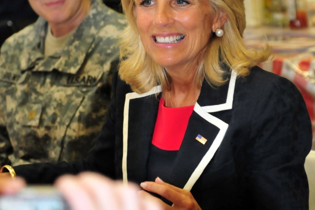 BAGHDAD - Dr. Jill Biden, Vice President Joe Biden's wife, listens to a story being told by a 1st Armored Division Soldier during an open forum held at the Sports Oasis dining facility on Camp Victory July 4. Jill Biden attended various celebrations on Victory Base Complex this Independence Day and mingled with the Soldiers. (U.S. Army photo by Sgt. Teri Hansen, 366th MPAD, USD-C)