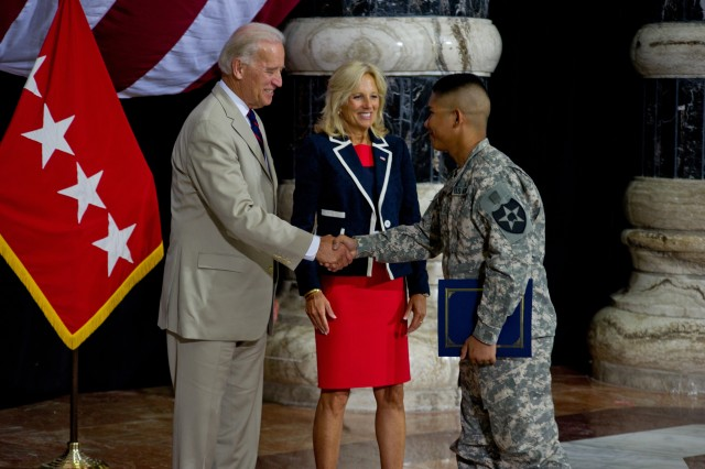 Vice President Joseph R. Biden Jr. and his wife, Dr. Jill Biden, congratulate a Soldier after becoming an American citizen. During a naturalization ceremony July 4 in Al Faw Palace at Camp Victory, Iraq, 156 servicemembers from 56 countries became U.S. citizens. Lori Scialabba, associate director of U.S. Citizenship and Immigration Services, administered the Oath of Citizenship. Gen. Raymond T. Odierno, USF-I commander, gave each new citizen his USF-I commanding general's coin, and his senior enlisted advisor, Command Sgt. Maj. Lawrence Wilson, presented a U.S. flag to each servicemember.