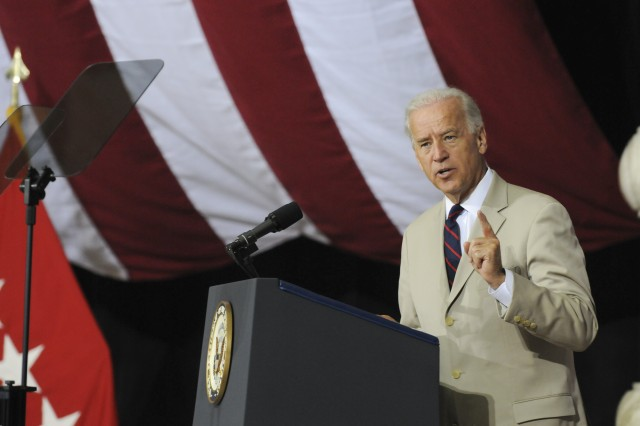 Vice President Joesph R. Biden, Jr. speaks at an Independence Day naturalization ceremony at Camp Victory's Al Faw Palace, July 4. One hundred fifty-six foreign-born U.S. servicemembers from 56 countries serving with United States Forces-Iraq, took the Oath of Citizenship at the event and became U.S. citizens. It was the 17th such ceremony held in Iraq since 2003.