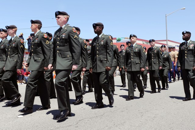 PRESIDIO OF MONTEREY, Calif. - Soldiers from the 229th Military Intelligence Battalion march in the 61st annual Seaside Independence Day parade at Seaside, Calif. July 4.