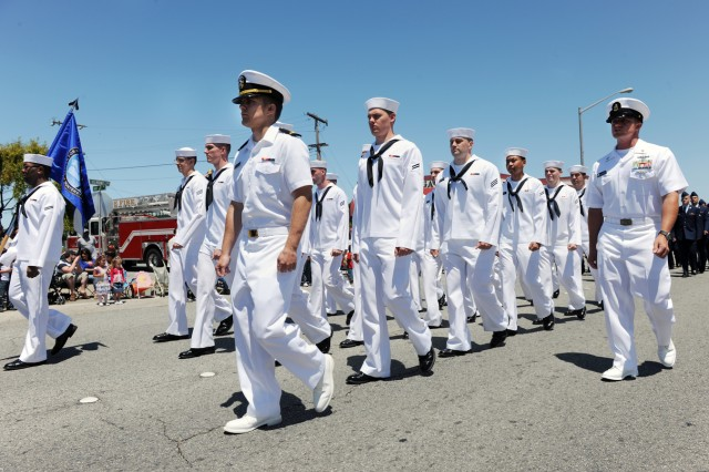 PRESIDIO OF MONTEREY, Calif. - Sailors from the Center of Information Dominance Detachment-Monterey march in the 61st annual Seaside Independence Day parade.