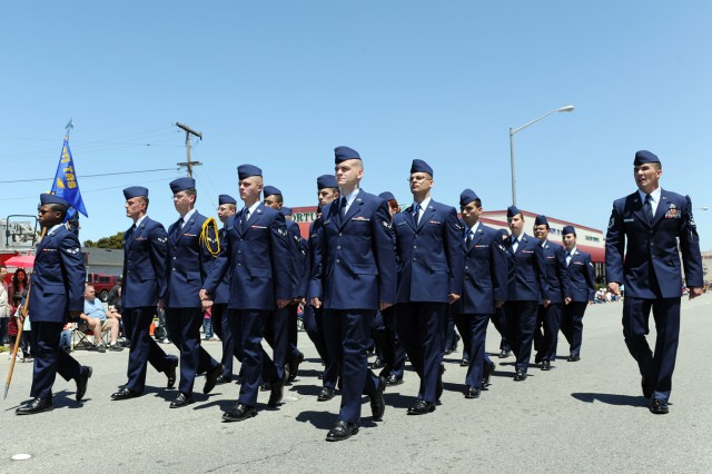 PRESIDIO OF MONTEREY, Calif. - Airmen from the 311th Training Squadron march in the 61st annual Seaside Independence Day parade at Seaside, Calif. July 4.