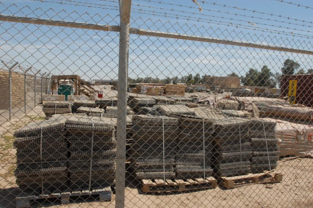 Pallets sit in a yard in Iraq. The Logistics Reporting Tool allows anything, from sandbags to SUVs, to be accounted for and tracked in real time, presenting commanders and logisticians across the theater with an unprecedented capability.