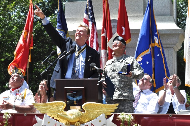Gen. George W. Casey Jr. and city officials observe the flyover at the Independence Day celebration on Scituate Common on Sunday, July 4, 2010.