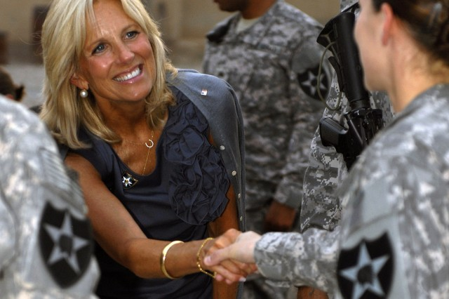 Dr. Jill Biden, the wife of the vice president of the United States, shakes hands with a Soldier from 4th Stryker Brigade Combat Team, 2nd Infantry Division, during a visit with the troops at a 4th of July barbecue.