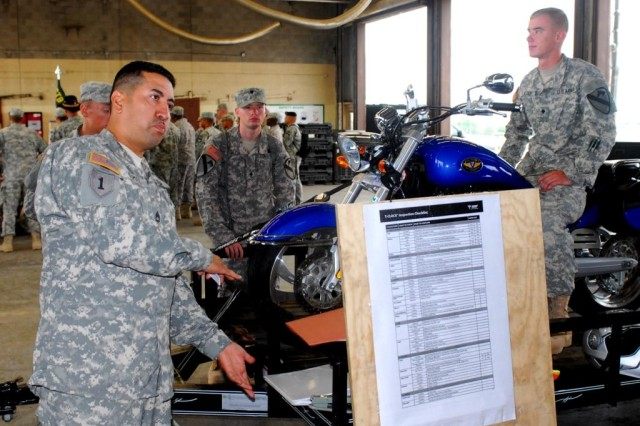 FORT HOOD, Texas- Sgt. 1st Class Carlos Gomez, from Laredo, Texas, a scout platoon sergeant with 2nd Special Troops Battalions, 2nd Brigade Combat Team, 1st Cavalry Division, demonstrates how the body moves when turning corners on a motorcycle during a safety day, here, July 1.