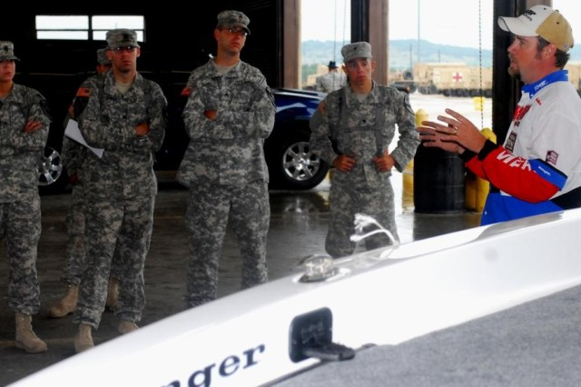 FORT HOOD, Texas- Eric Wendeborn (right), from Temple, Texas, explains proper boat handling and safety procedures to a group of Soldiers from 2nd Special Troops Battalion, 2nd Brigade Combat Team, 1st Cavalry Division, during a safety day on Fort Hood, Texas, July 1.