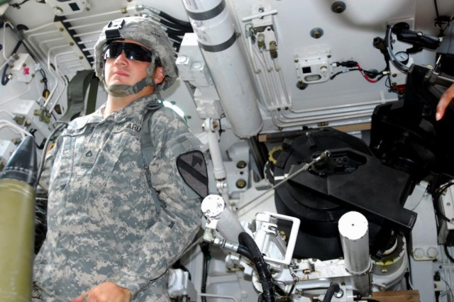 FORT HOOD, Texas- Pfc. Bryan Zimmerman, a Colombia, Tenn. native and a canon crew member with 3rd Battalion., 82nd Field Artillery Regiment, 2nd Brigade Combat Team, 1st Cavalry Division, pulls the cord on a self-propelled, 155mm howitzer during training provided by the Collective Training and Evaluation Team on Fort Hood, Texas, June 29.
