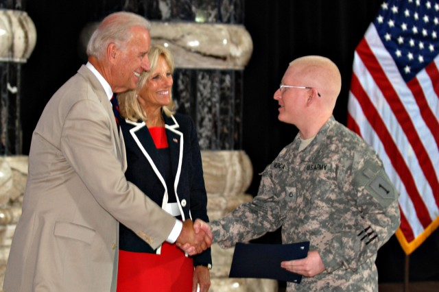 Pfc. Jose Murcia, a Soldier with 1st Attack Reconnaissance Battalion, 1st Aviation Regiment, Combat Aviation Brigade, 1st Infantry Division and native of El Salvador, shakes hands with Vice President Joe Biden after becoming a U.S. citizen in a Fourth of July naturalization ceremony at Camp Victory's Al-Faw Palace.