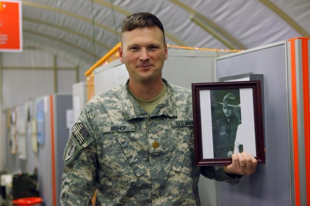 Maj. Donald Bishop, with the 1st Sustainment Brigade, holds the picture of his grandfather Cpl. Gus Bishop who was severely injured at the battle of the Meuse-Argonne in World War I.
