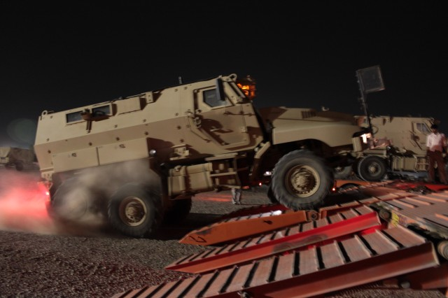A Mine Resistant Ambush Protected vehicle being loaded up in Joint Base Balad as part of the Durable Express. The Durable Express is part of the 1st Sustainment Brigade's mission in the Responsible Drawdown of Forces from Iraq.