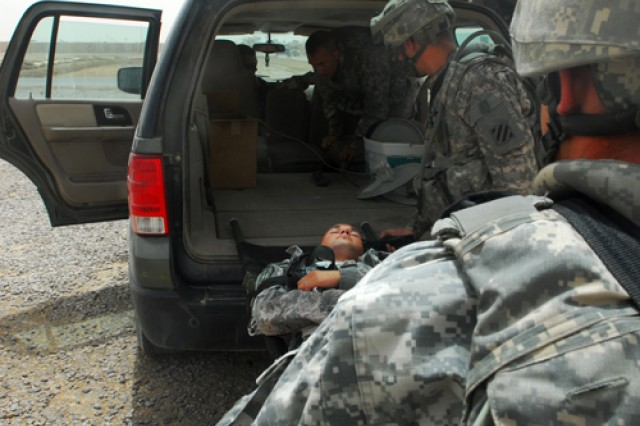 Spc. Matt Edgeworth, of Cleveland, Tenn., light-wheel vehicle mechanic with 252nd Military Police Co., playing a mock-casualty, is loaded up during a mass casualty exercise on Contingency Operating Base Delta, June 25, 2010. The military term CASEVAC stands for casualty evacuation and denotes using a non-medical vehicle to transport personnel, as opposed to medical evacuation, or MEDEVAC.