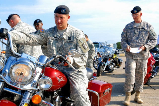 Sgt.1st Class Richard Ahlers (right), a motorcycle mentor, inspects 1st Lt. Darrell Sheppeard's motorcycle during the 4th Sustainment Brigade's motorcycle safety week June 25 at Fort Hood, Texas. (U.S. Army photo by Pfc. Amy M. Lane)