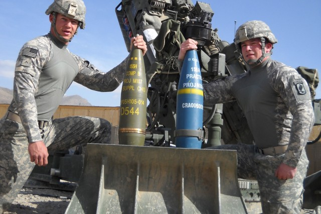 Staff Sgt. Michael Kain and Pvt. William Fiel of Battery A, 4th Squadron, 319th Airborne Field Artillery Regiment, 173rd Airborne Brigade Combat Team, display the round used for civilian casualty reduction.