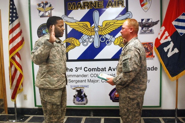 Sgt. Anthony Hister (left), Headquarters and Headquarters Company, 3rd Combat Aviation Brigade, Task Force Falcon, from Marked Tree, Ark., recites the oath of a noncommissioned officer, with 1st Sgt. Christopher Wood, HHC, 3rd CAB, TF Falcon, from Lancaster, Pa., after being promoted to the rank of sergeant at Bagram Airfield, Afghanistan, July 5.