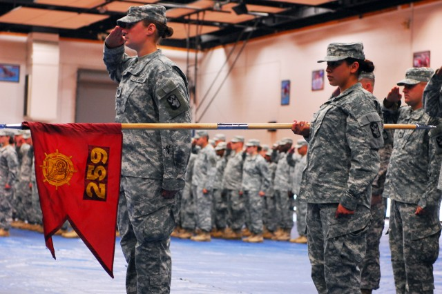 Soldiers with the 59th Transportation Detachment render honors to the colors during their deployment ceremony held at Abram's Field House on Fort Hood, Texas July 3. The unit is headed to Camp Phoenix, Afghanistan for a 12 month tour of duty. (U.S. Army photo by Spc. Alisha Hauk)