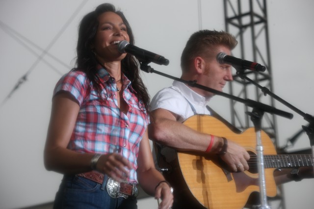 """Joey + Rory grace the stage at Fort Sill's Polo Field July 2, 2010, for the Independence Day weekend concert. The married couple became a performing group in 2008 after competing on """"CMT's Can You Duet"""" and continues to tour the"""